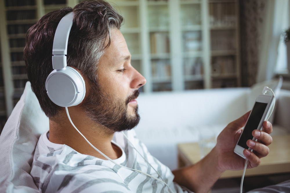 Man listening to music on headphones at home-1